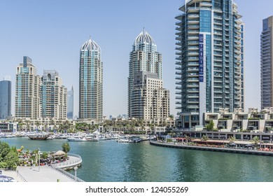 DUBAI, UAE - SEPTEMBER 29: View of modern skyscrapers in Dubai Marina on September 29, 2012 in Dubai, UAE. Dubai Marina - artificial canal city, carved along a 3 km stretch of Persian Gulf shoreline.
