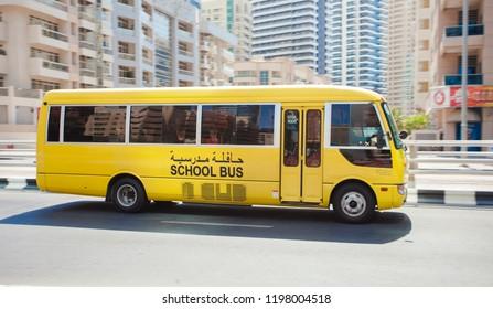 DUBAI, UAE - SEPTEMBER 30 2018: School bus driving in Dubai city, United Arab Emirates