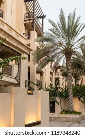 DUBAI, UAE - SEPTEMBER 5, 2014:  Low-rise residential apartments and palm trees in The Old Town, a development by Emaar that draws inspiration from traditional Arab architecture, in Downtown Dubai