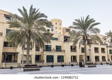 DUBAI, UAE - SEPTEMBER 5, 2014: Low-rise residential apartments and palm trees in The Old Town, a development by Emaar that draws inspiration from traditional Arab architecture, in Downtown Dubai, UAE