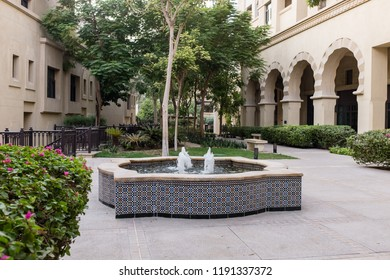 DUBAI, UAE - SEPTEMBER 5, 2014: Courtyard with a tiled fountain in The Old Town, a residential development by Emaar that draws inspiration from traditional Arab architecture, in Downtown Dubai, UAE