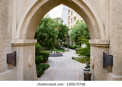 DUBAI, UAE - SEPTEMBER 5, 2014: Archway leading to a communal park in The  Old Town, a residential development by Emaar that draws inspiration from traditional Arab architecture.