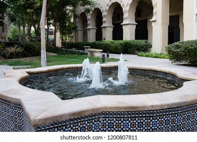 DUBAI, UAE - SEPTEMBER 5, 2014: A tiled fountain in The Old Town, a residential development by Emaar that draws inspiration from traditional Arab architecture, in Downtown Dubai, UAE