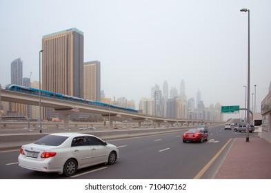 DUBAI, UAE - SEPTEMBER 5, 2017: Traffic on Sheikh Zayed road against the skyscrapers in Dubai, United Arab Emirates
