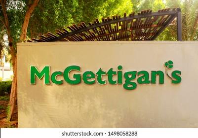 Dubai / UAE - September 5, 2019: Logo sign of Mcgettigans irish pub on outdoor wall in JLT.