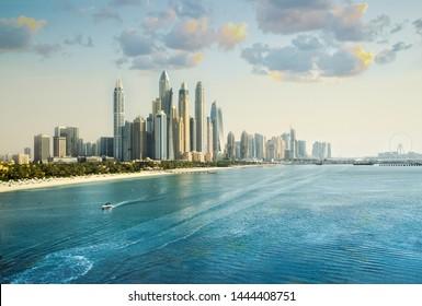 Dubai, UAE United Arabs Emirates. City of skyscrapers, Dubai marina at sunset. Front line beach hotels and blue water of Persian gulf