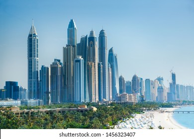 Dubai, UAE United Arabs Emirates - 29 May, 2019: City of skyscrapers, Dubai marina in the sunny day with front line of   beach hotels and blue water of Persian gulf