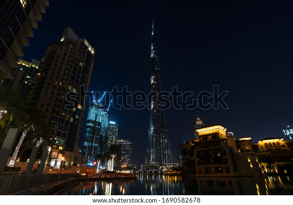 Dubai, UAE.03/25/2020. Downtown DUbai, the posh area around the famous Burj Khalifa without the usual crowds of residents and tourist. The famous light show on the tower was also temporary suspended.