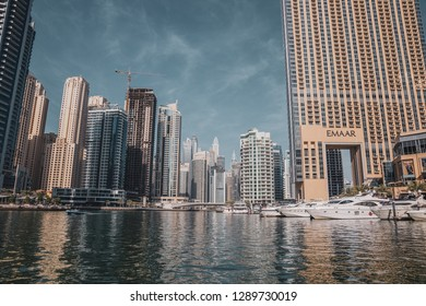 Dubai / United Arab Emirates - 01-17-2019- yachts parked in Dubai Marina by the residential and office towers, Dubai Marina is a project by Emaar