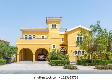 Dubai / United Arab Emirates - 02-26-2019 : state of the art, big yellow villa house in dubai, in the villa project Dubai. Private covered car parking also avaialbe