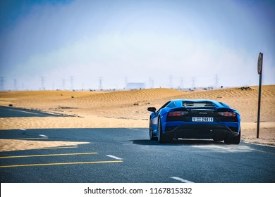 Dubai / United Arab Emirates - 04/05/2018: The Lamborghini Aventador S supercar on a quiet Dubai road in the desert