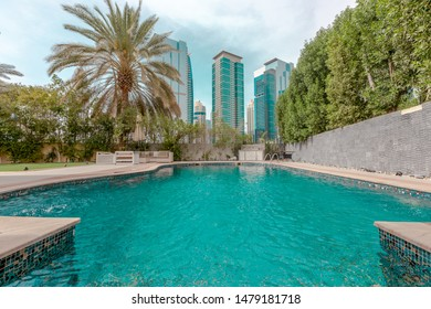Dubai / United Arab Emirates - 04-06-2019 : Beautiful swimming pool in a house with a Skyline view of dubai's famous JLT area, Scenic beautiful cloudy day