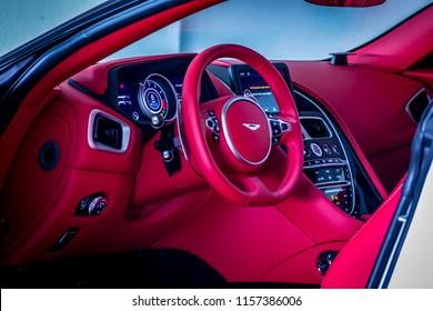 Dubai / United Arab Emirates - 07/29/2018: The red leather interior the Aston Martin DB11 V8 in a Dubai car park