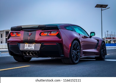 Dubai / United Arab Emirates - 08/16/2018: The rear end of the Chevrolet Corvette Z06 sports car on an empty road at dawn with villas in the background