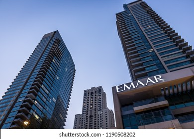 Dubai / United Arab Emirates - 09/28/2018: The Dubai Marina skyline is shown from the ground with several Emaar-branded buildings