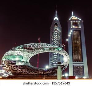 Dubai, United Arab Emirates; 1 April 2019; modern museum of the future under construction, Emirates Towers at night.