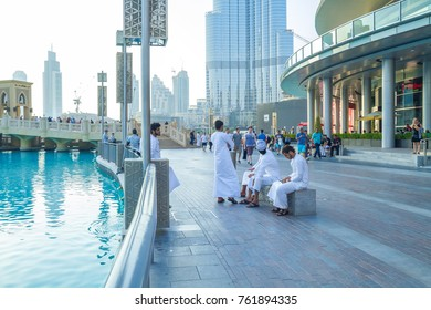 Dubai, United Arab Emirates, 15.11.2015 Peoples and city street. Sunny day in Urban city, water and buildings. It's a travel photo.