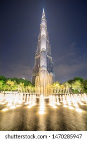 Dubai, United Arab Emirates - 2 November, 2018: Awesome night view of scenic fountain and the iconic Burj Khalifa Tower at downtown. Amazing cityscape. Dubai is a popular tourist destination of UAE.