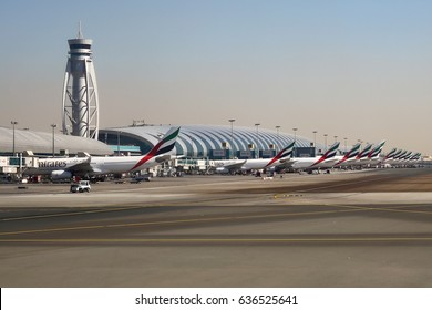 DUBAI, UNITED ARAB EMIRATES - 21ST JANUARY 2016 - Emirate Airlines A330s, 777s and A380s line up at Terminal 3 Dubai International Airport DXB.