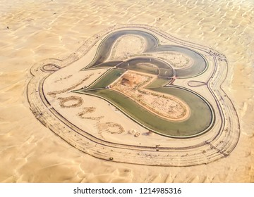 dubai, United Arab Emirates, 26th, October 2018: aerial view of man made, heart shaped Al Qudra Lakes in a desert near Dubai