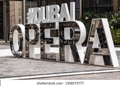 "Dubai, United Arab Emirates; 3 April 2019; ""Dubai Opera"" letter figurines on a street at Emaar square"