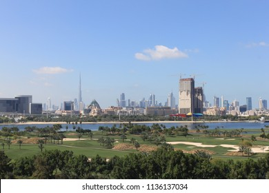 Dubai, United Arab Emirates, 4.3.2010 - Dubai Golf Course at sunny bright day with a cityscape at the background