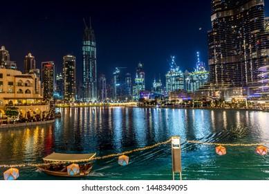 Dubai, United Arab Emirates - 7 MAY 2019: Dubai Downtown night with Burj Khalifa and other towers paniramic view from the top in Dubai, United Arab Emirates. music fountain show. UAE.