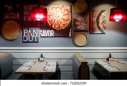 DUBAI UNITED ARAB EMIRATES - 9 SEPTEMBER 2017: Interior design in low light in Pizza Hut restaurant franchize of empty table, conceptual. Great Lives. Great Friends. Great Pizza