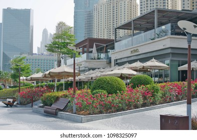 Dubai, United Arab Emirates - April  01, 2018: Hilton Hotel and restaurants with green recreation areas are located in the business part of the capital of the Arab country.