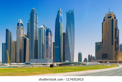 Dubai, United Arab Emirates - April 15, 2018: Skyscrapers and yachts in Dubai Marina