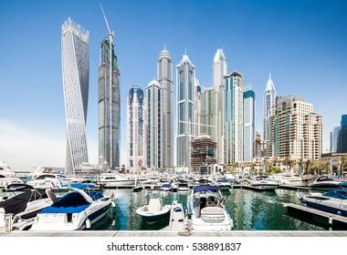 DUBAI, UNITED ARAB EMIRATES, APRIL 28, 2016: Dubai marina bay with yachts on a sunny day