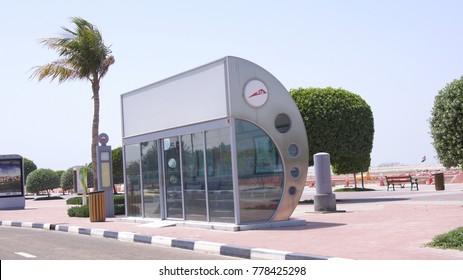DUBAI, UNITED ARAB EMIRATES - APRIL 1st, 2014: An air conditioned bus stop with a palm tree in the background