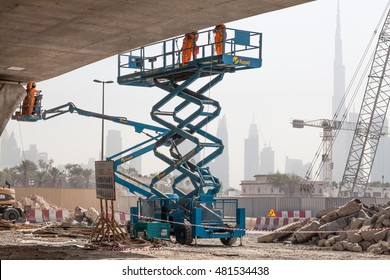 Dubai, United Arab Emirates - August 12, 2016 - Access platforms working on a new bridge going over the Dubai Water Canal Project