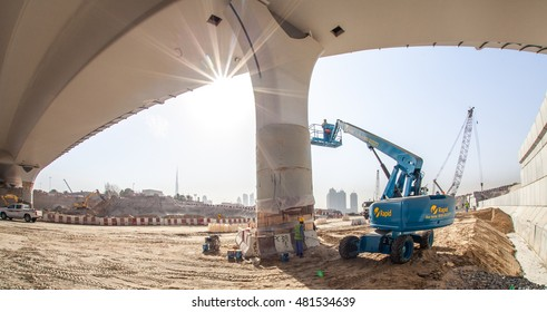 Dubai, United Arab Emirates - August 12, 2016 - Boom lift working on a new bridge going over the Dubai Water Canal Project