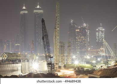 Dubai, United Arab Emirates - August 12, 2016 - Cranes working on the new Dubai Water Canal Project at night