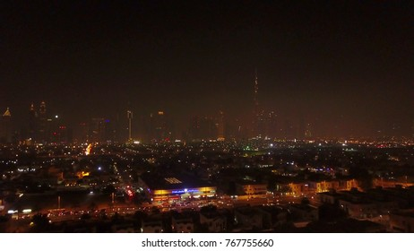 Dubai, United Arab Emirates. The beauty of Dubai Marina, reflections in water aerial view. Luxury city. Promenade top view. Dubai in the evening. The evening lights of the skyscrapers of Dubai - the