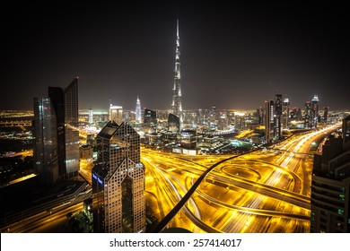 DUBAI, UNITED ARAB EMIRATES - CIRCA DECEMBER 2012 - Burj Khalifa, tallest building in the world, standing over Sheikh Zayed Road at night.