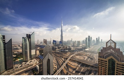 DUBAI, UNITED ARAB EMIRATES - CIRCA DECEMBER 2012 - Burj Khalifa, tallest building in the world, standing over Sheikh Zayed Road during the day.