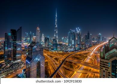 DUBAI, UNITED ARAB EMIRATES - DEC 13, 2017: Burj Khalifa, Downtown Skycrapers and Sheikh Zayed Road in Dubai at Night on Dec 13, 2017