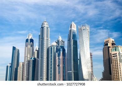 Dubai, United Arab Emirates - December 26, 2017: urban landscape on blue sky background. Success, future concept. Architecture, structure, design. Business, commerce, finance.
