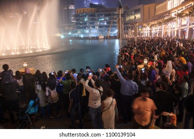 Dubai, United Arab Emirates. December 25, 2017. a crowd of people watching the show singing fountains.