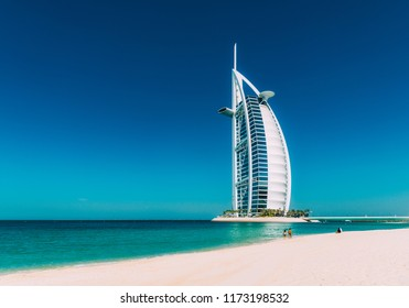 Dubai, United Arab Emirates - December 10, 2014: The Burj Al Arab Hotel on the beach near Madinat Jumeriah Resort. The Burj Al Arab is a luxury hotel located in Dubai, United Arab Emirates.
