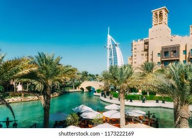 Dubai, United Arab Emirates - December 09, 2014: The Burj Al Arab Hotel (middle) and the Madinat Jumeriah Resort (right side) are luxury hotels located in Dubai, United Arab Emirates.
