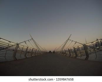 Dubai, United Arab Emirates - December 18 2016: A view of the pedestrian only bridge at dusk in Safa Park in Dubai!