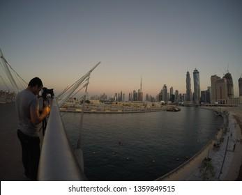 Dubai, United Arab Emirates - December 18 2016: A view of the Dubai Skyline along with the pedestrian bridge in Safa Park