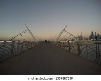 Dubai, United Arab Emirates - December 18 2016: A fish eye view of the pedestrian bridge and Dubai Skyline from Safa Park