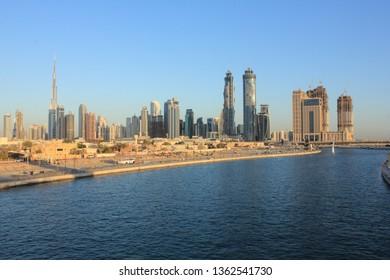 Dubai, United Arab Emirates - December 19 2016: A view of the Dubai skyline along with the Dubai Canal from the Safa Park
