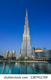 Dubai, United Arab Emirates - December 11, 2018. Burj Khalifa skyscraper view over the Dubai fountain from the Burj Park in sunny day.