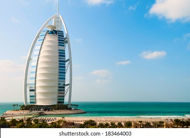 """DUBAI, UNITED ARAB EMIRATES - DECEMBER, 10, 2013: A general view of the world's first seven stars luxury hotel Burj Al Arab """"Tower of the Arabs"""", also known as """"Arab Sail"""""""