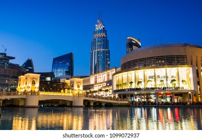 DUBAI, UNITED ARAB EMIRATES - FEBRUARY 5, 2018: Dubai mall modern architecture reflected in the fountain at blue hour. The Dubai Mall is the largest mall in the world by total area